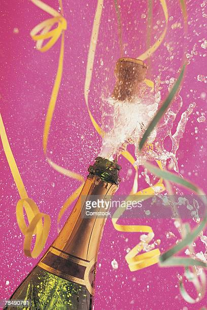 Cork popping on champagne during celebration