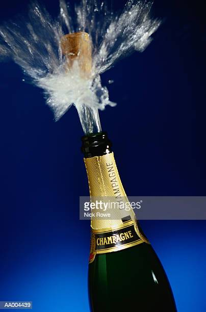 Cork Popping Out of a Champagne Bottle