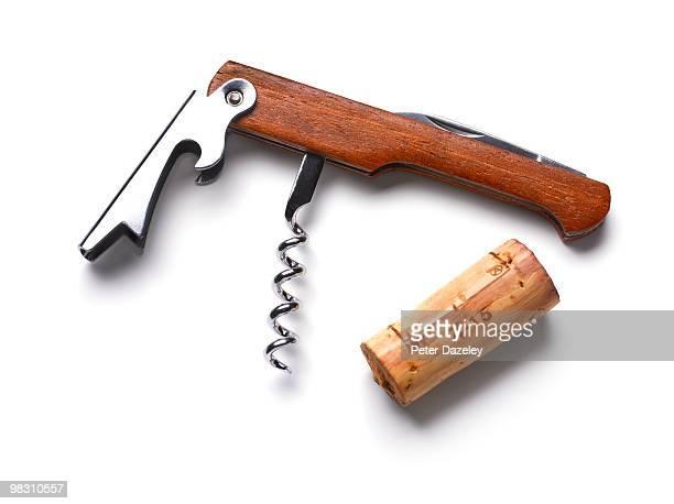 Cork screw and wine cork on white background