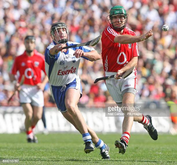 Cork's Jerry O'Connor hand passes the ball during the Guinness All Ireland Hurling Championship Quarter Final match against Waterford at Croke Park...