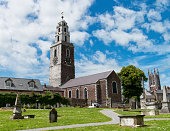Cork, Ireland - June 30, 2014: Shandon Bells Church in Cork City photographed from the graveyard with a cloudy cloudy summer's sky.
