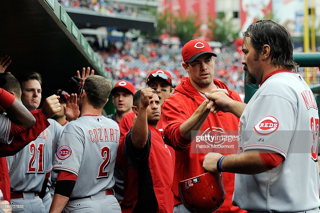 <a gi-track='captionPersonalityLinkClicked' href=/galleries/search?phrase=Corky+Miller&family=editorial&specificpeople=224796 ng-click='$event.stopPropagation()'>Corky Miller</a> #37 of the Cincinnati Reds celebrates in the dugout after scoring on a sacrifice fly ball by <a gi-track='captionPersonalityLinkClicked' href=/galleries/search?phrase=Zack+Cozart&family=editorial&specificpeople=6889199 ng-click='$event.stopPropagation()'>Zack Cozart</a> #2 in the top of the eighth inning during a game against the Washington Nationals at Nationals Park on April 28, 2013 in Washington, DC.