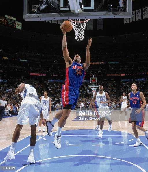 Corliss Williamson of the Detroit Pistons shoots a layup during the game against the Denver Nuggets at the Pepsi Center on March 6 2004 in Denver...