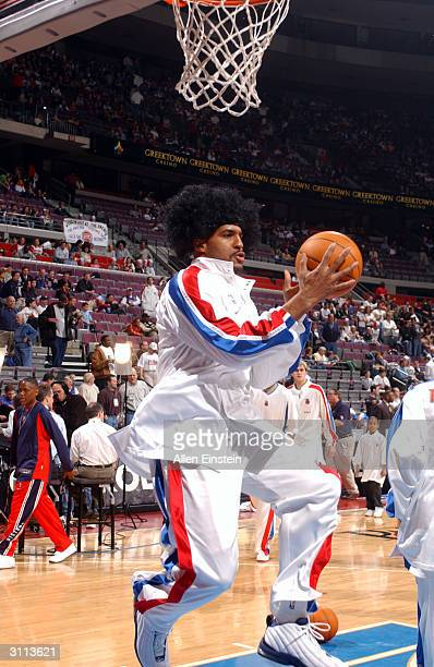 Corliss Williamson of the Detroit Pistons wears a Ben Wallace afro wig as he warms up for his game against the Denver Nuggets during a game March 19...