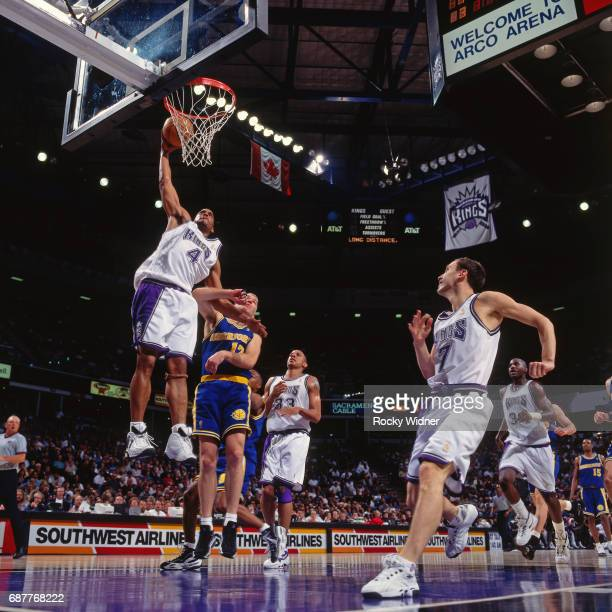 Corliss Williamson of the Sacramento Kings dunks against the Golden State Warriors circa 1996 at Arco Arena in Sacramento California NOTE TO USER...