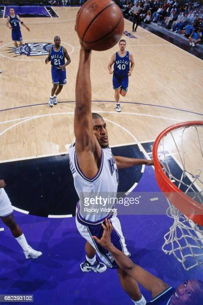 Corliss Williamson of the Sacramento Kings dunks circa 1996 at Arco Arena in Sacramento California NOTE TO USER User expressly acknowledges and...