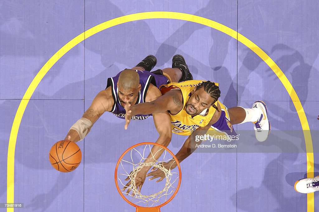 Corliss Williamson of the Sacramento Kings goes strong to the hoop against Ronny Turiaf of the Los Angeles Lakers on March 2 2007 at Staples Center...