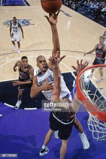 Corliss Williamson of the Sacramento Kings shoots against Chicago Bulls circa 1996 at Arco Arena in Sacramento California NOTE TO USER User expressly...