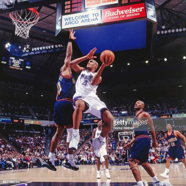 Corliss Williamson of the Sacramento Kings shoots against the Denver Nuggets circa 1996 at Arco Arena in Sacramento California NOTE TO USER User...