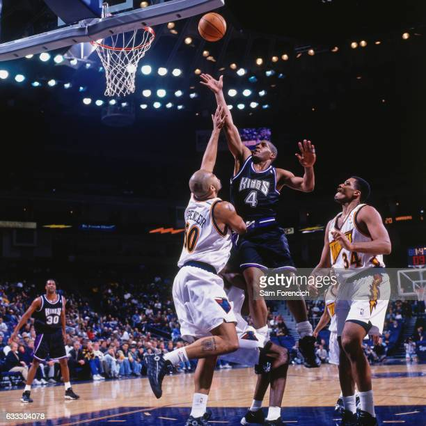 Corliss Williamson of the Sacramento Kings shoots against the Golden State Warriors during a game played on December 12 1997 at the Arena in Oakland...