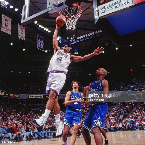 Corliss Williamson of the Sacramento Kings shoots against the Orlando Magic circa 1996 at Arco Arena in Sacramento California NOTE TO USER User...