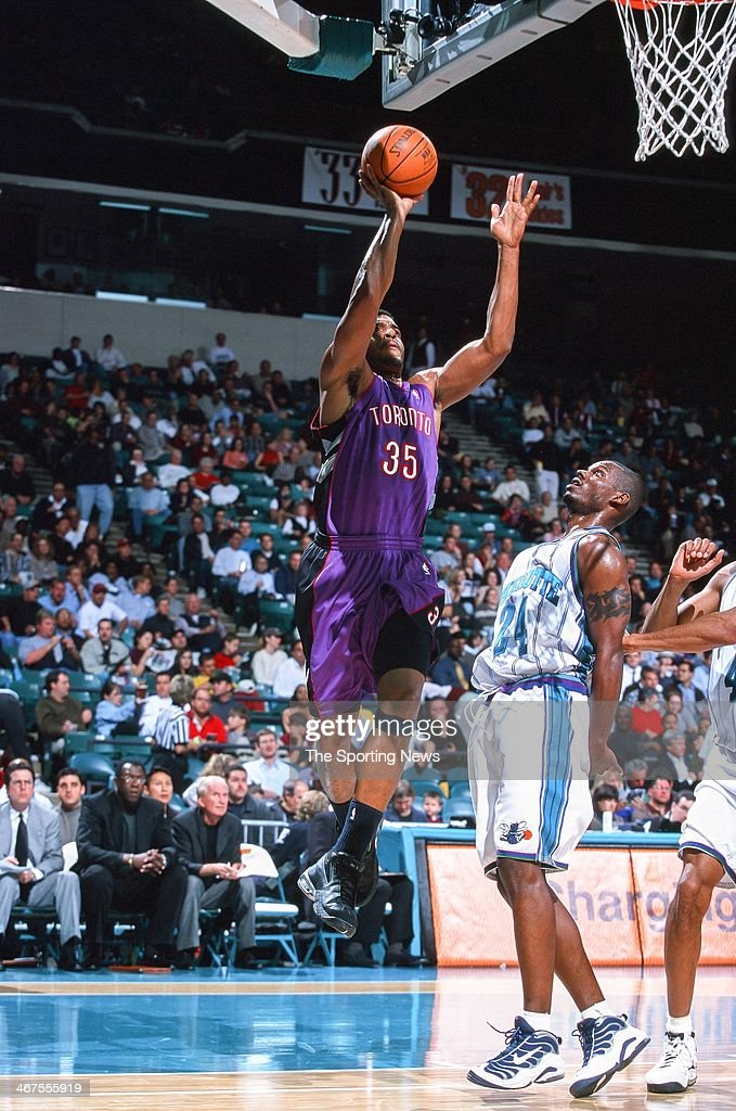 Corliss Williamson of the Toronto Raptors shoots during the game against the Charlotte Hornets on November 29 2000 at Charlotte Coliseum in Charlotte...