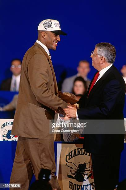 Corliss Williamson shakes hands with NBA Commissioner David Stern after he was selected number thirteen overall by the Sacramento Kings during the...