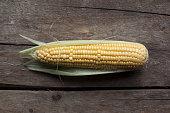 Corn cob on wooden table