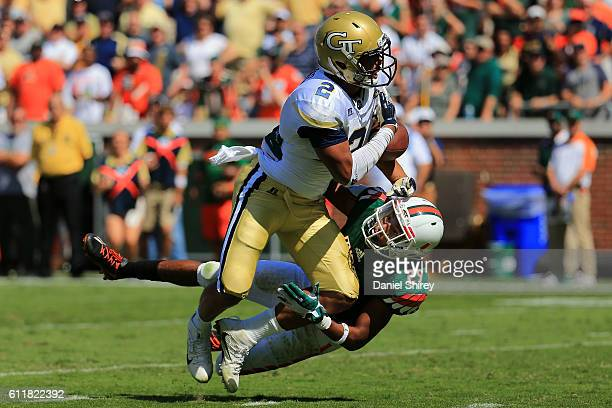 Corn Elder of the Miami Hurricanes breaks up a pass intended for Ricky Jeune of the Georgia Tech Yellow Jackets during the second half at Bobby Dodd...
