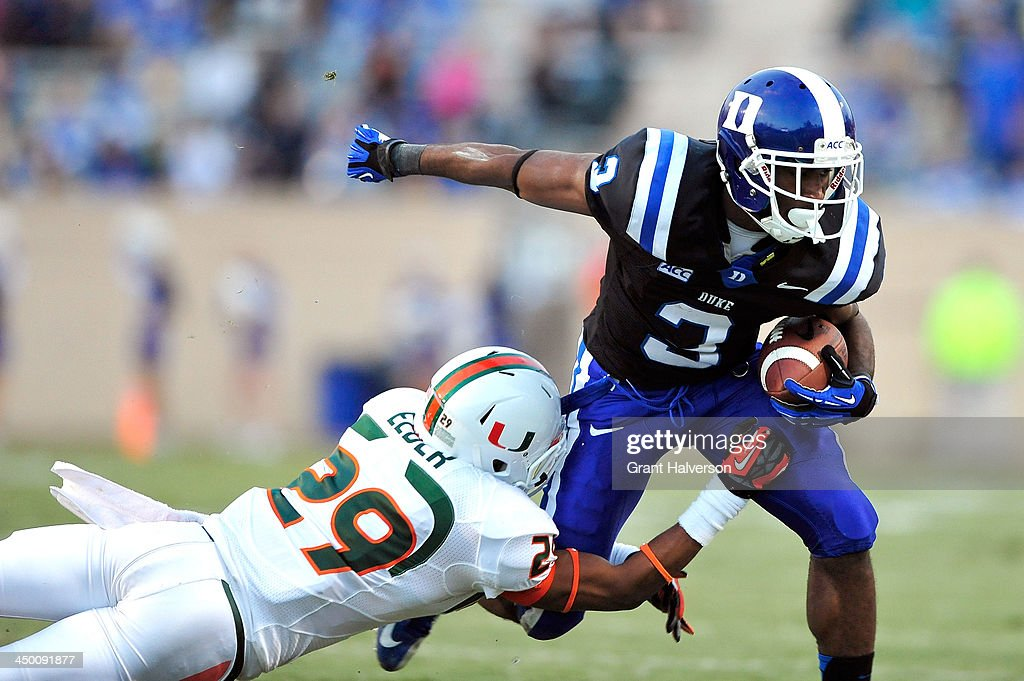 Corn Elder #29 of the Miami Hurricanes makes a diving tackle to stop Jamison Crowder #3 of the Duke Blue Devils during play at Wallace Wade Stadium on November 16, 2013 in Durham, North Carolina.