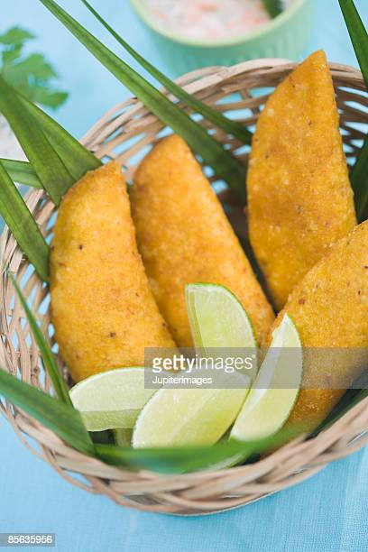 Corn empanadas and lime in basket