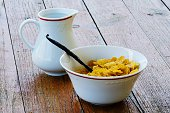 Corn Flakes And Milk Jar On Wooden Table Outdoors