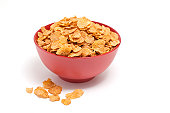 Corn flakes in a red bowl
