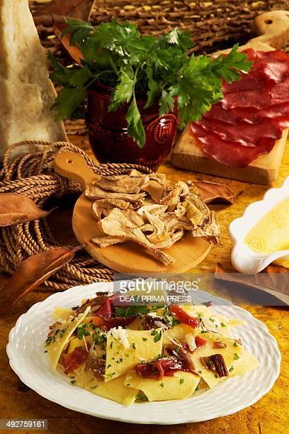 Corn maltagliati with bresaola and mushrooms