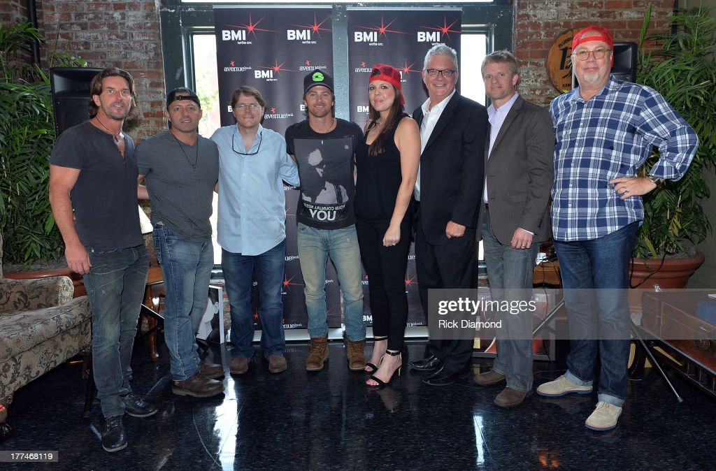 Corn Man Music's Brett James, co-writer Dan Couch, Corn Man Music's Nate Lowery, Kip, MCA Nashville's Miranda McDonald, BMI's Perry Howard, BMG Chrysalis' Kos Weaver, and Capitol Records' Mike Dungan attend the BMI #1 Party For 'Hey Pretty Girl' By <a gi-track='captionPersonalityLinkClicked' href=/galleries/search?phrase=Kip+Moore&family=editorial&specificpeople=8375431 ng-click='$event.stopPropagation()'>Kip Moore</a> at Flying Saucer Draught Emporium on August 22, 2013 in Nashville, Tennessee.