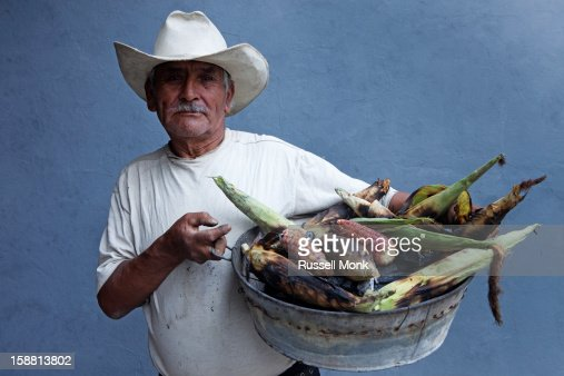 A corn seller with his corn : Stock Photo