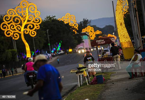 Corn vendors are seen on a street in Managua on January 17 2015 AFP PHOTO/ Inti OCON