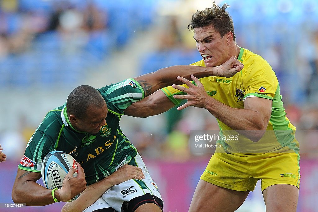 Cornal Hendricks of South Africa is tackled by Ed Jenkins of Australia during the Gold Coast Sevens Cup semi final match between Australia and South africa at Skilled Stadium on October 13, 2013 on the Gold Coast, Australia.