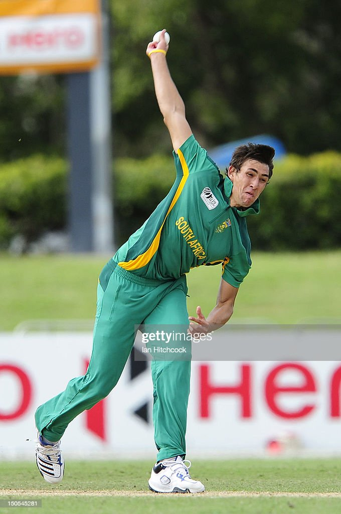 Corne Dry of South Africa bowls during the ICC U19 Cricket World Cup 2012 Semi Final match between Australia and South Africa at Tony Ireland Stadium on August 21, 2012 in Townsville, Australia.