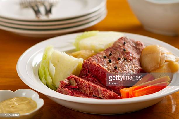 Corned beef dinner with cabbage, onion and carrots