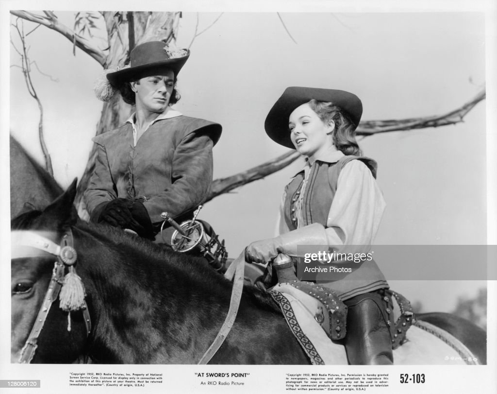 <a gi-track='captionPersonalityLinkClicked' href=/galleries/search?phrase=Cornel+Wilde&family=editorial&specificpeople=227460 ng-click='$event.stopPropagation()'>Cornel Wilde</a> and an unidentified actress on horseback in a scene from the film 'At Sword's Point', 1952.