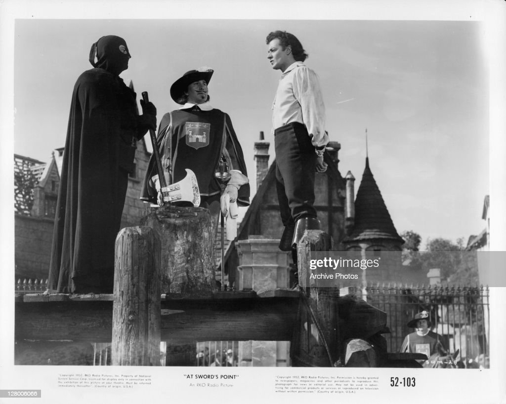<a gi-track='captionPersonalityLinkClicked' href=/galleries/search?phrase=Cornel+Wilde&family=editorial&specificpeople=227460 ng-click='$event.stopPropagation()'>Cornel Wilde</a> (left) and others in a scene from the film 'At Sword's Point', 1952.