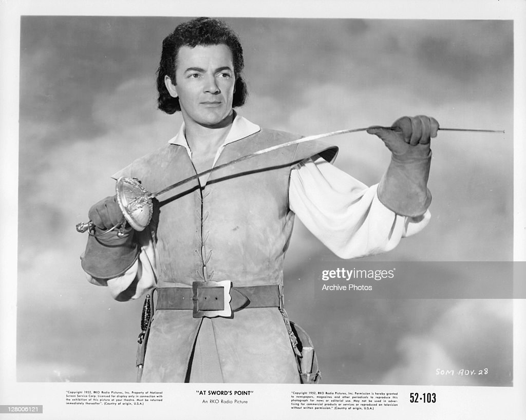 <a gi-track='captionPersonalityLinkClicked' href=/galleries/search?phrase=Cornel+Wilde&family=editorial&specificpeople=227460 ng-click='$event.stopPropagation()'>Cornel Wilde</a> with sword in a scene from the film 'At Sword's Point', 1952.