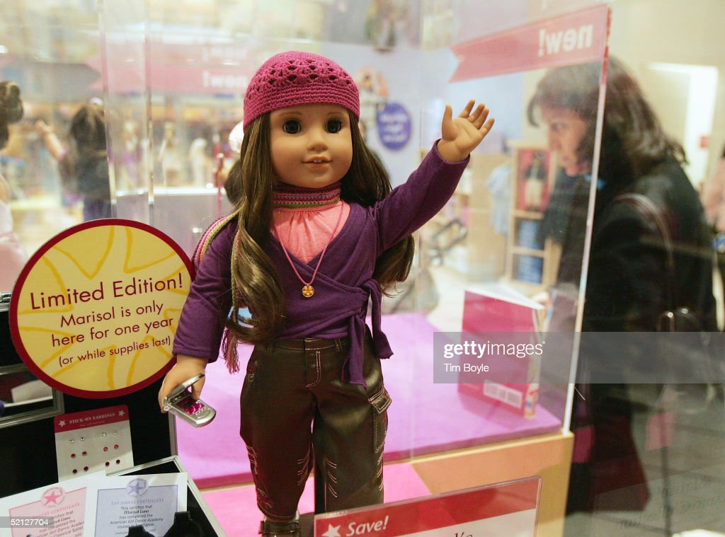 Cornelia Alasu looks at American Girl doll Marisol Luna and some of her accessories at the American Girl Place store February 3 2005 in Chicago...
