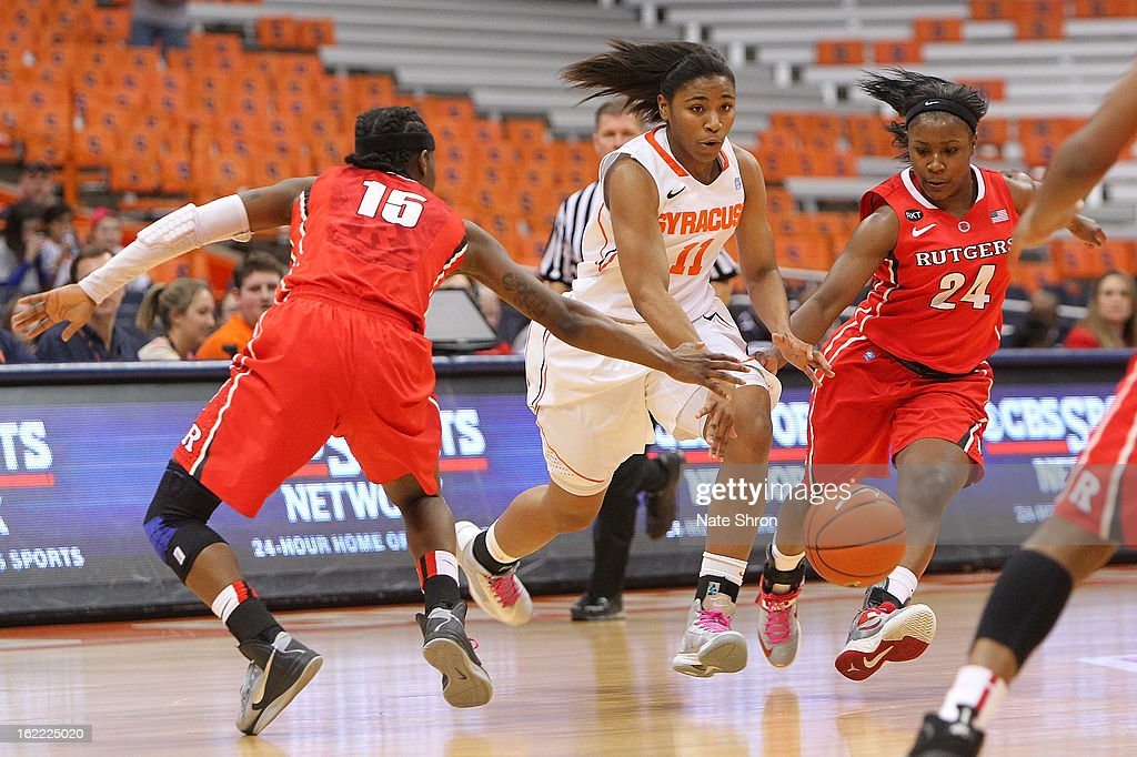 Cornelia Fondren #11 of the Syracuse Orange drives to the basket against Syessence Davis #15 and Shakena Richardon #24 of the Rutgers Scarlet Knights during the game at the Carrier Dome on February 19, 2013 in Syracuse, New York.