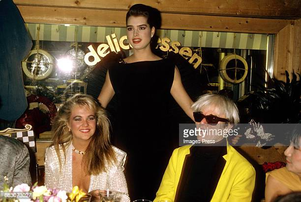 Cornelia Guest Brooke Shields and Andy Warhol attend the Launch party for Pierre Cardin's perfume Maxim's at Macy's New York circa 1985 in New York...