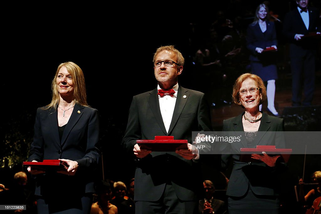 Cornelia Isabella Bargmann of the Rockefeller University, USA, Winfried Denk of the Max Planck Institute for Medical Research, Germany, and Ann M. Graybiel of the Massachusetts Institute of Technology, USA, stand on stage after receiving the prestigious 2012 Kavli prize for neuroscience, in Oslo, on September 4, 2012. AFP PHOTO / SCANPIX NORWAY / ERLEND AAS