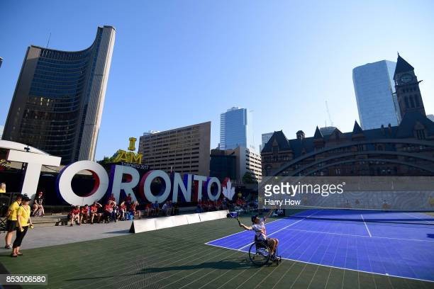 Cornelia Oosthuizen of The United Kingdom serves in a wheelchair tennis preliminary match against Canada during the Invictus Games 2017 at Nathan...