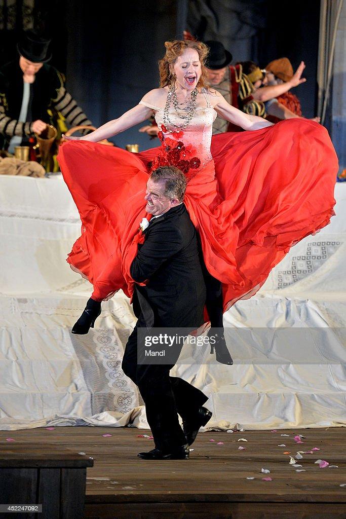 Cornelius Obonya (Everyman) and Brigitte Hobmeier (Paramour) are seen during the photo rehearsal of 'Jedermann' (Everyman) on the Domplatz ahead of Salzburg Festival 2014 on July 16, 2014 in Salzburg, Austria.