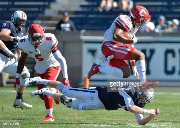 Cornell University linebacker Ijhad Bonner hurdles Yale Bulldogs quarterback Kurt Rawlings after the interception during a college football game...