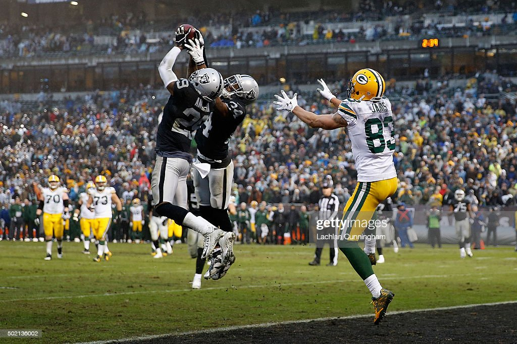 Corner Back <a gi-track='captionPersonalityLinkClicked' href=/galleries/search?phrase=David+Amerson&family=editorial&specificpeople=7244765 ng-click='$event.stopPropagation()'>David Amerson</a> #29 of the Oakland Raiders intercepts a pass thrown by Quarterback Aaron Rodgers #12 of the Green Bay Packers in the fourth quarter at O.co Coliseum on December 20, 2015 in Oakland, California.