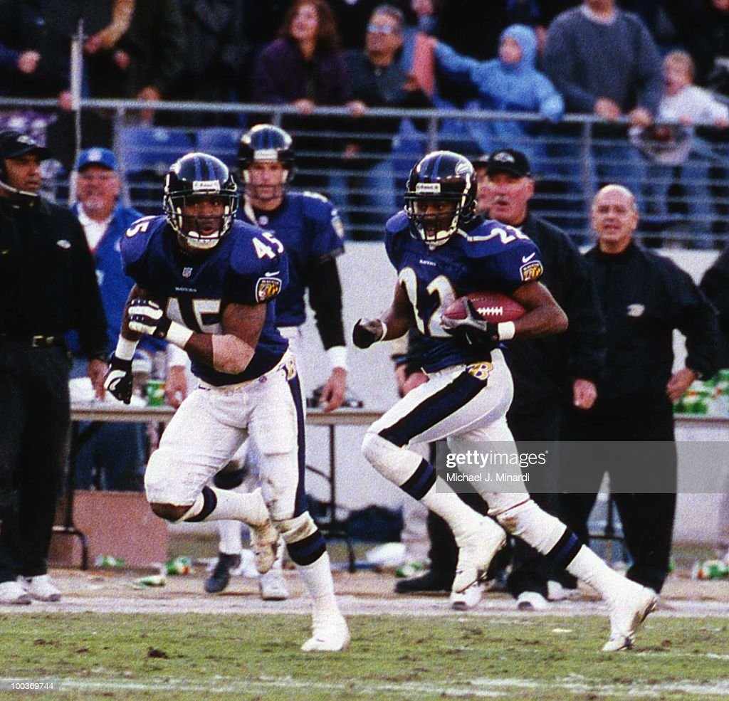 Corner back Duane Starks #22 of the Baltimore Ravens intersepts a pass from the Cleveland Browns and makes some good yardage with the help oh his teammate Safety Corey Harris #45. The Ravens won 44 to 7.