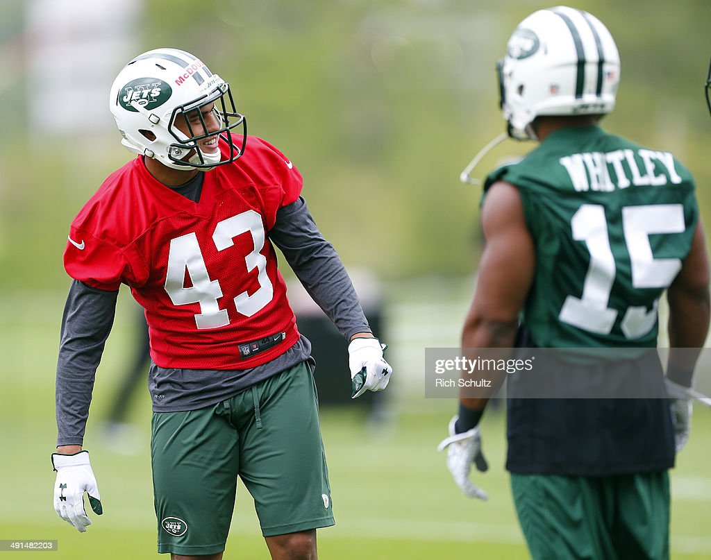 Corner Backs Dexter McDougle #43 and E.J. Whitley #15 of the New York Jets gets set to run a play during the first day of rookie minicamp on May 16, 2014 in Florham Park, New Jersey.
