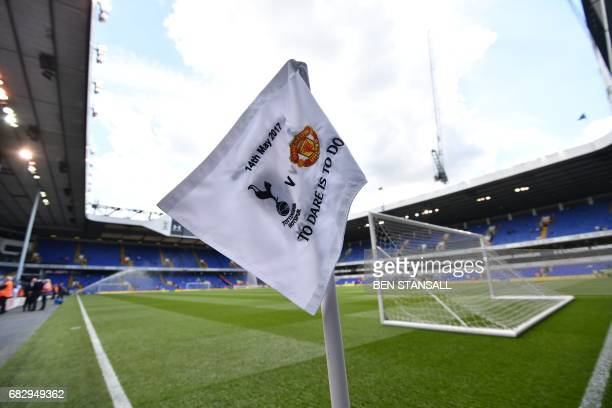 A corner flag showing the fixture is seen inside White Hart Lane in London on May 14 2017 ahead of the English Premier League football match between...