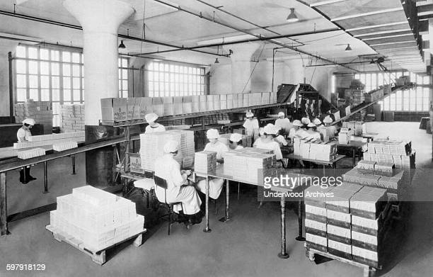 A corner of the packing department at the American Chicle Company where millions of boxes of gum are wrapped and packed for shipping Long Island City...