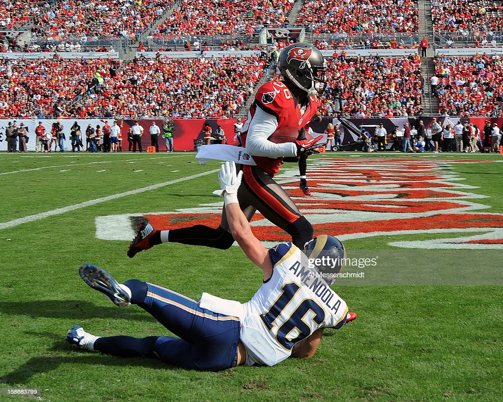 Cornerback Anthony Gaitor #26 of the Tampa Bay Buccaneers runs up the field with an interceptions against the St. Louis Rams December 23, 2012 at Raymond James Stadium in Tampa, Florida. The Rams won 28 - 13.