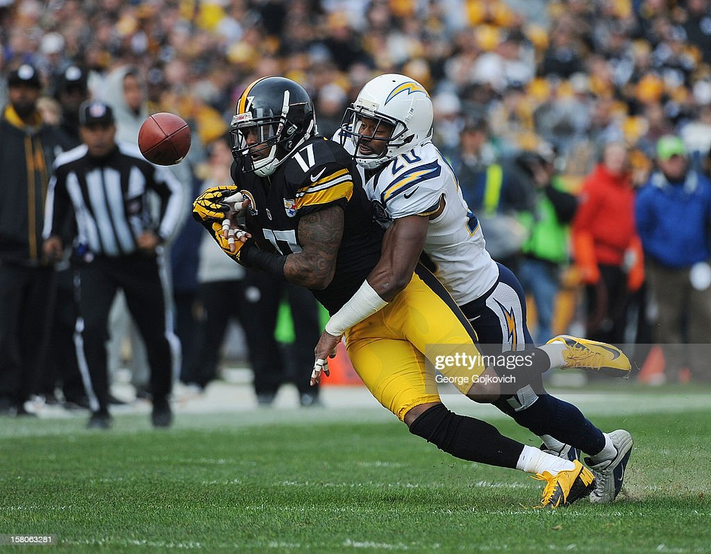 Cornerback Antoine Cason #20 of the San Diego Chargers breaks up a pass intended for wide receiver Mike Wallace #17 of the Pittsburgh Steelers during a game at Heinz Field on December 9, 2012 in Pittsburgh, Pennsylvania. The Chargers defeated the Steelers 34-24.