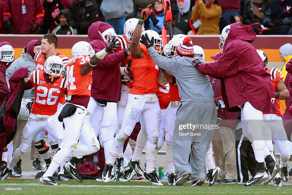 Cornerback Antone Exum #1 of the Virginia Tech Hokies celebrates with teammates after intercepting a pass against the Virginia Cavaliers at Lane Stadium on November 24, 2012 in Blacksburg, Virginia.