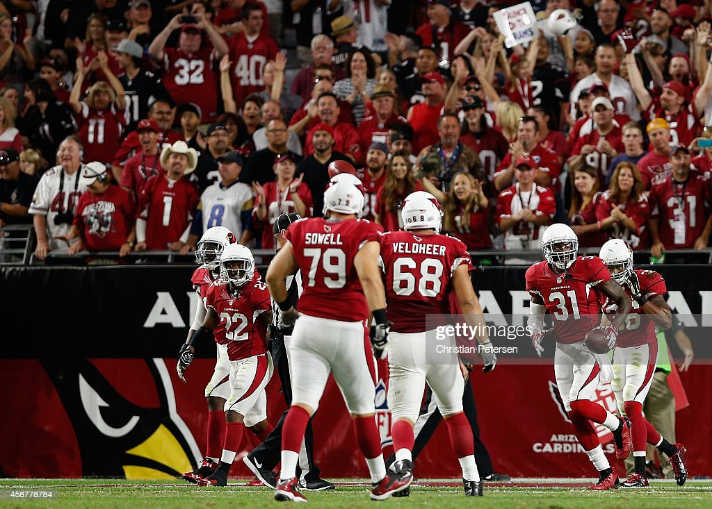 Cornerback Antonio Cromartie of the Arizona Cardinals celebrates in the endzone after scoring on a 14 yard fumble recovery touchdown against the St...