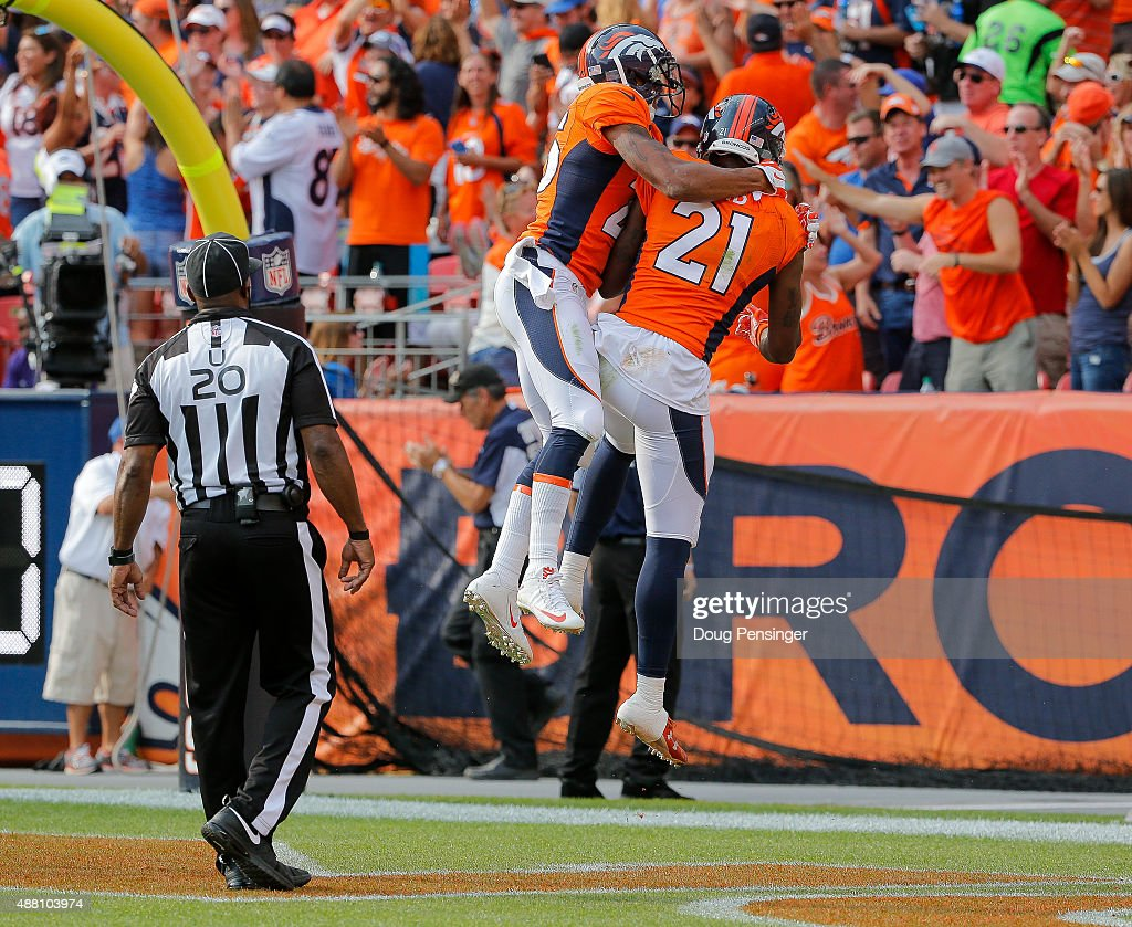 Cornerback <a gi-track='captionPersonalityLinkClicked' href=/galleries/search?phrase=Aqib+Talib&family=editorial&specificpeople=4037138 ng-click='$event.stopPropagation()'>Aqib Talib</a> #21 of the Denver Broncos celebrates with cornerback <a gi-track='captionPersonalityLinkClicked' href=/galleries/search?phrase=Chris+Harris+-+American+Football+Cornerback&family=editorial&specificpeople=15029474 ng-click='$event.stopPropagation()'>Chris Harris</a> #25 after returning an interception for a touchdown in the third quarter of a game at Sports Authority Field at Mile High on September 13, 2015 in Denver, Colorado.